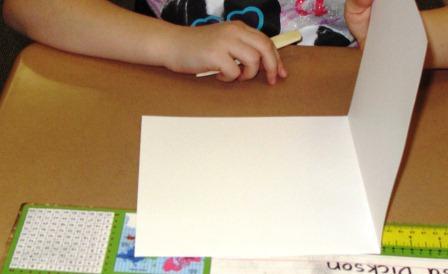 "A 16"" x 8"" paper folded in half"