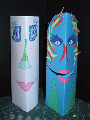 crayon and cut paper decorations on the puppets