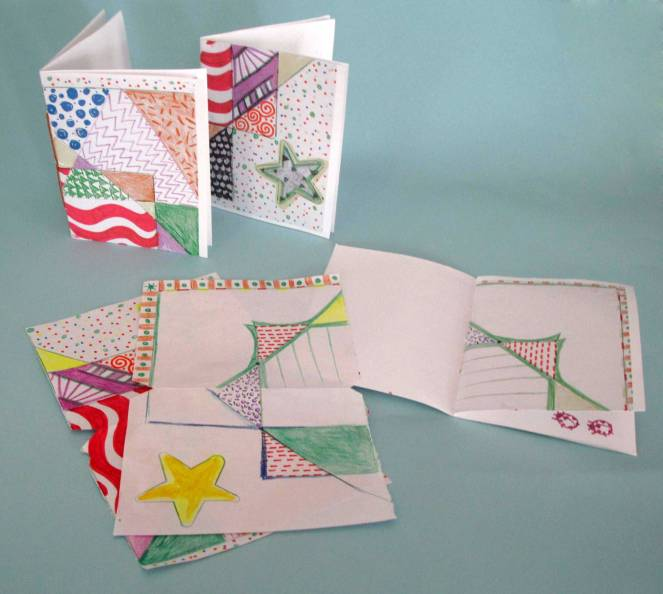 Three little books which were made fromcopied, decoratedpaper which was thencut, nested and sewn.
