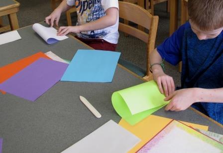 Third Graders folding paper