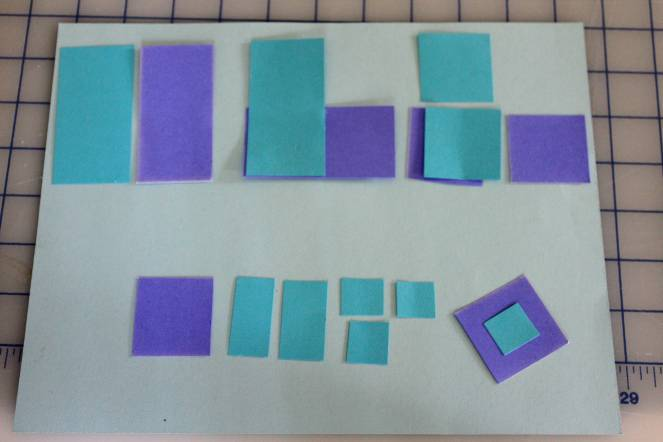 Dominoes, cut into squares, then half squares, which turn out to be a scaled down domino, then halved again to make small squares