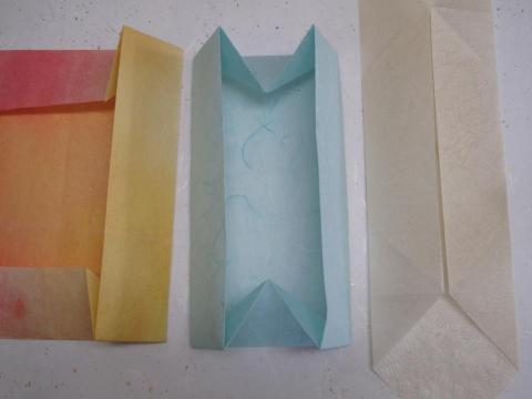 Using thin papers to make the Zhen Xian Bao