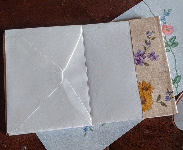Envelope book wrapped with Wallpaper Sample Cover