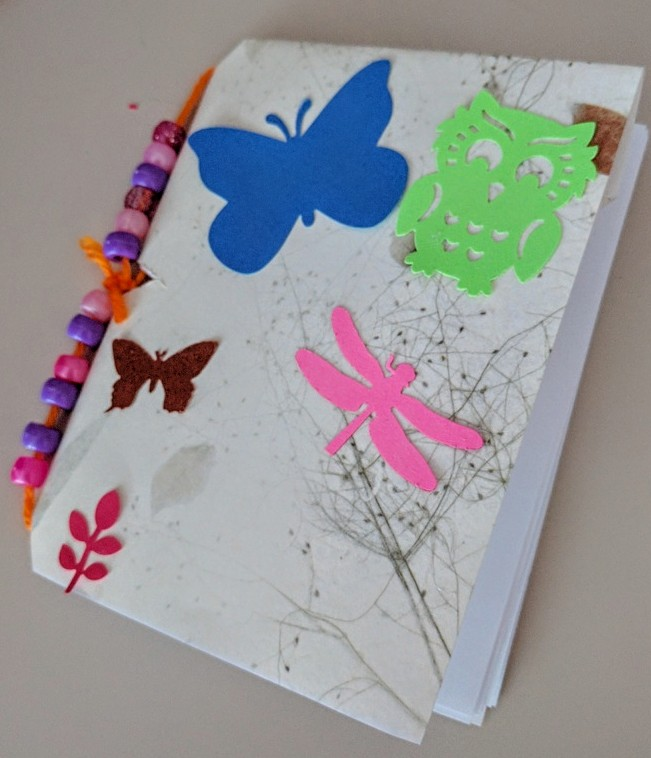 Second and Third graders made sewn book with beads