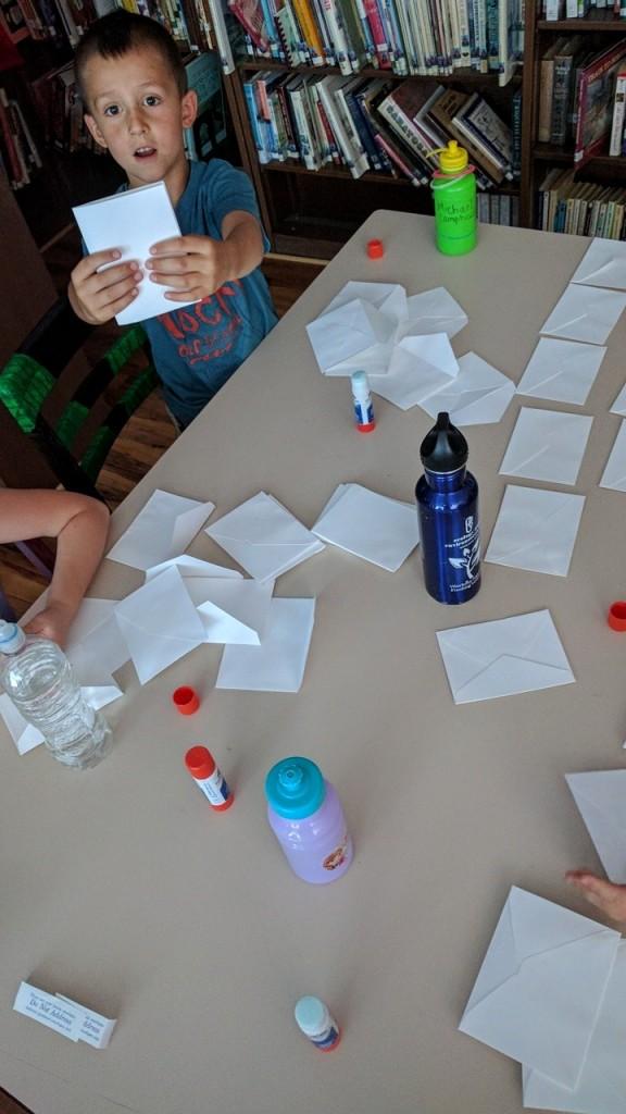 First graders assembling their books