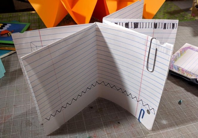 Making a larger origami pamphlet by linking two halves together