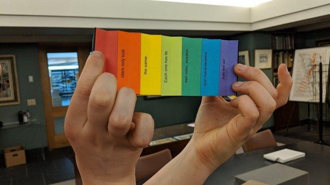 Angela holding Ed's Rainbow Galaxy